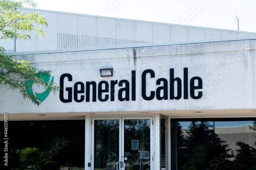 Fototapeta premium Brampton, On, Canada - July 10, 2021: Close up of General Cable sign on the building in Brampton, On, Canada. General Cable is an American multinational cable manufacturing company.