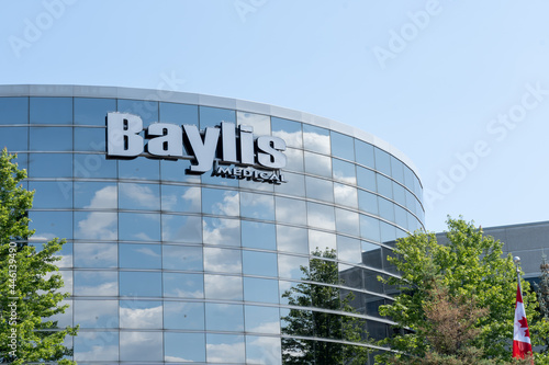 Fototapeta premium Mississauga, On, Canada- July 10, 2021: Close up of Baylis sign on their Toronto office in Mississauga, On, Canada. Baylis Medical is a Canadian company develops medical devices.