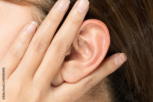 耳クローズアップ・若い女性. Fotobehang