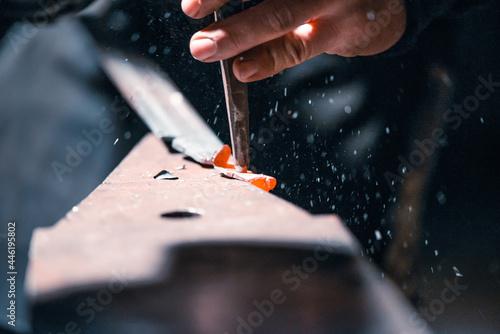 Murais de parede Close-up of the hands of a blacksmith during artistic forging.