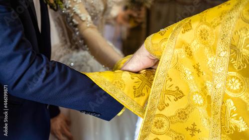 Billede på lærred Orthodox priest serving in a church. Wedding ceremony