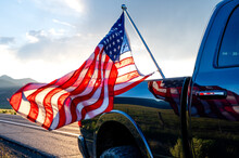 USA Flag Sticking From The Black Pickup Truck Cargo In Bridgeport, California, USA