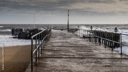 Fotografie, Obraz Stormy sea and windswept jetty during a storm  in Suffolk Uk