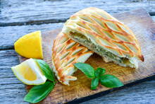 Tasty Smokend  Salmon  And Broccoli Pie . Salmon In Puff Pastry.. Home Made Healty  Quiche ,lemon  And Fish On Wooden Background