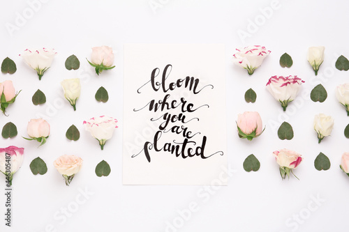 Canvas Print Frame of beautiful flowers and paper card with handwritten text Bloom where you