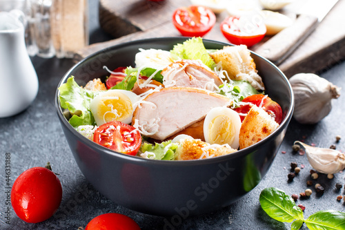 Obraz na plátně A delicious chicken caesar salad with parmesan cheese, dressing and croutons