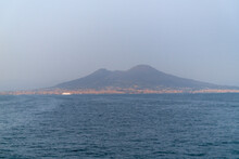 Defocused Background Of Vesuvius And The City Of Naples Seen From The Sea.