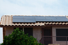Close Up Of Solar Water Panel Heating On Red Tiled House Roof With Lightning Protection Skylights