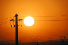 Landscape Of Transmission Tower Silhouettes Under The Sunlight During A Beautiful Sunset