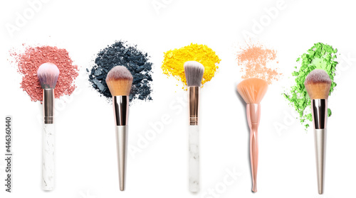 Fotografie, Tablou Makeup brushes with crushed eyeshadows on white background