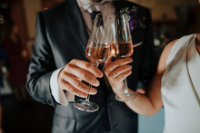 Loving Newlyweds With Glasses With Champagne