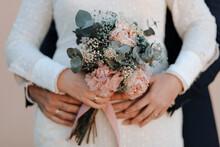 Elegant Newlyweds With Wedding Bouquet