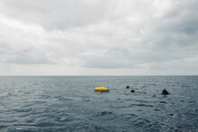 Anonymous Person Scuba Diving On Sea Water