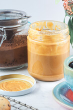 Glass Jars With Peanut Butter And Chocolate Powder
