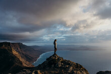 Traveling Woman Observing Sea From Viewpoint In Highlands