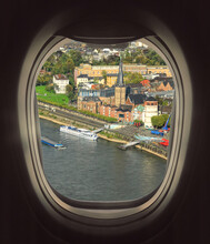 Looking Through The Airliner Window Out. Beautiful Scenic Overhead Airplane View Of Dusseldorf City And Rhine River. Flying Over The Northern Rhine Westphalia, Germany