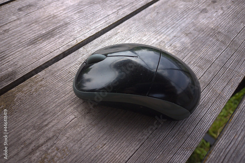 Fotografie, Obraz wireless computer mouse on a table made of old chalkboards