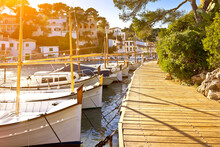 White Fishing Boats Moored At A Wooden Walkway In The Beautiful Town Cala Figuera, Majorca Or Mallorca, Sunflare Effect.