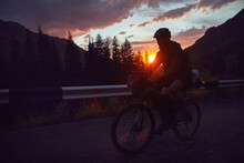 Silhouette Of A Bicyclist At Sunset In The Mountain