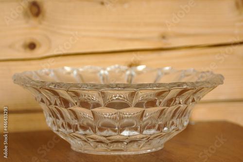 Fotografie, Obraz A vintage glass salad bowl against a wooden wall