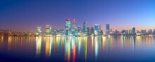 Panoramic Shot Of Perth Skyline At Dawn With Colorful Building Lights Reflected On Water