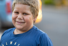 Head And Shoulders Of One Boy Looking At Camera And Smiling
