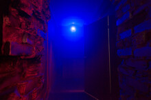 Lamp In Neon Blue Light In Fog With Red Bricks