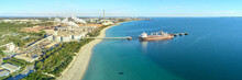 Panoramic Shot Of Kwinana Alumina Refinery On A Sunny Day With Industrial Plant And Docked Ship