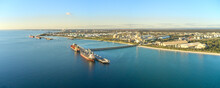 Panoramic Shot Of Kwinana Bulk Jetty With Large Ship Docked At The Port On A Sunny Day