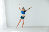 blonde woman dancing to music in training