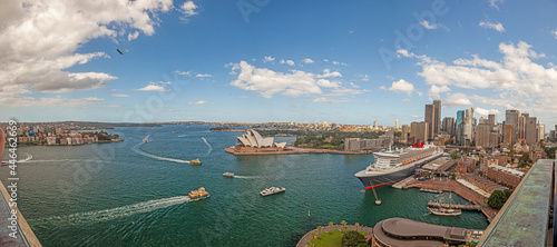 Obraz na plátně Aerial panoramic view of Sydney harbor from Harbor Bridge with skyline, opera ho