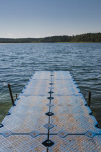 Plastic Floating Pier On The Lake For Swimming And Boat Mooring