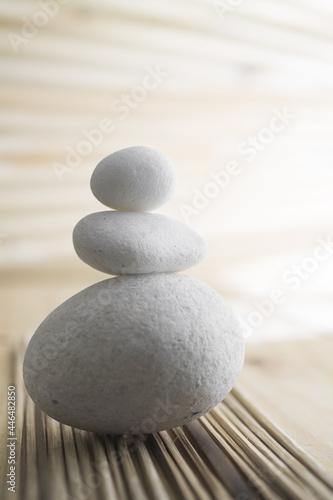 Fototapeta Vertical shot of white stones on a blurred background
