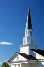 Closeup Of White Church Steeple With Blue Sky