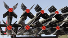 """Rockets On The Launch Pad Of The Legendary Soviet Mortar """"Katyusha"""" On Blue Sky Background In Outdoor Museum - An Artillery Rocket Weapon Of Victory In The Second World War 1941-1945"""