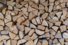 Neatly Folded, Chopped Firewood. Harvesting Firewood For The Winter, Preparing For The Heating Season.