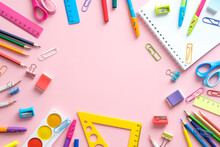 School Supplies On A Pink Background With Copy Space, Top View. Back To School Concept.