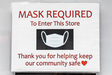 Face Mask Requirement Sign On A Business During The Covid-19 Pandemic.