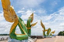 Close-up Low Angle Of Twin Green Naga Statue At The Mekong River, Wat Lamduan Temple, Nong Khai Province Thailand. Most Famous Landmark.
