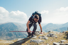 Male Hiker With Trekking Pole In Mountains