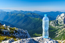 A Blue Water Bottle On The Top Of The Mountain In The Right Corner