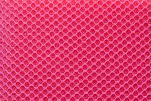 Full Frame Pink Hexagon Mesh Pattern Background.