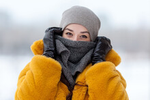 Woman In A Fur Coat Wrapped In A Scarf In The Winter Outdoors