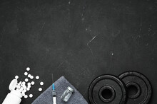 Different Drugs And Sports Equipment On Black Background, Flat Lay With Space For Text. Doping Control