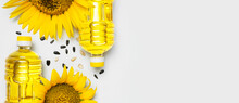 Plastic Bottles With Sunflower Oil, Fresh Yellow Sunflowers, Sunflower Seeds On Gray Background. Harvest Time Agriculture Farming Oil Production. Healthy Oils, Food. Flat Lay Top View Copy Space