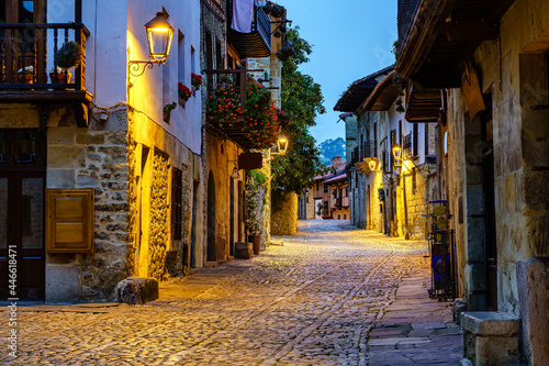 Canvastavla Narrow alley of old stone town with cobbled streets illuminated at night