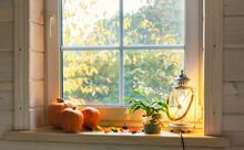 Orange Pumpkins On Windowsill, Candles, Autumn Leaves, Lantern.