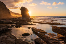 Golden Sunset Over The Giant Monolith Of Roque Del Moro, Cofete Beach, Jandia Nature Park, Fuerteventura, Canary Islands, Spain