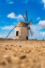 Traditional Windmill In The Rural Landscape Of Tefia, Fuerteventura, Canary Islands, Spain