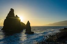 Ilheus Da Rib And Ribeira Da Janela Rock Formations Lit By Sun Rays At Dawn Ocean, Porto Moniz, Madeira, Portugal